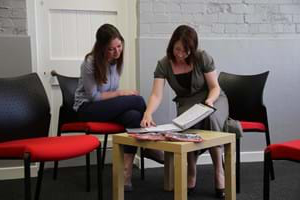 A student sitting with a member of staff in the innovation, careers and enterprise centre