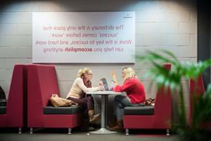 students studying together in a booth in the university learning centre