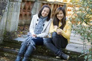 two students sitting together outside