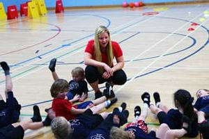 Hartpury student teaching a group of school children